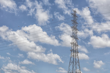 The electricity pylon for supply the electric power with the cloud sky scene.
