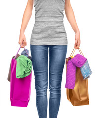 Woman with shopping bag on white