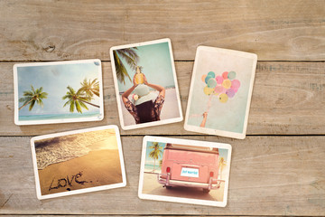 Photo album remembrance and nostalgia of journey honeymoon trip in summer on wood table. beach holiday relaxation. instant photo of vintage camera - vintage and retro styles