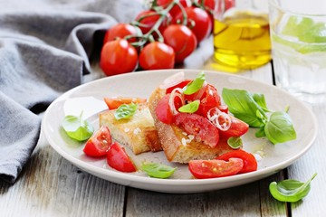 Bruschetta with tomatoes,shallot and basil. Selective focus
