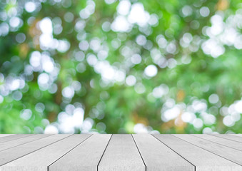 Wood table top on bokeh nature green background