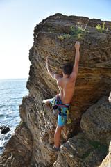 Foto op Aluminium Alpinisme man climbing on a rock