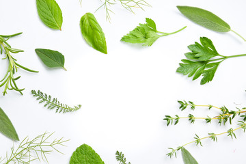 variety of fresh herbs on white background