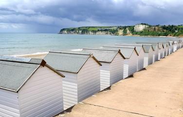Jurassic Coast with beach huts in Seaton, Devon