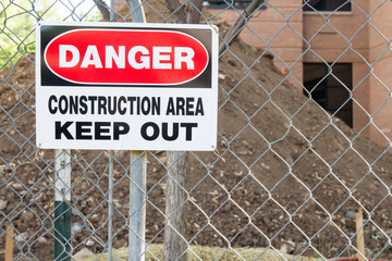 Danger construction Area Keep Out sign in front of a pile of dirt