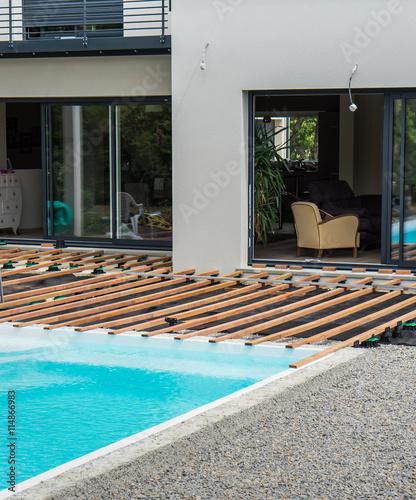 terrasse en pourtour de piscine stock photo and royalty free images on pic 114866983. Black Bedroom Furniture Sets. Home Design Ideas
