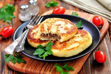 Potato cakes with meat and onions