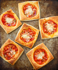 Puff pies with tomato, red onion and cheese