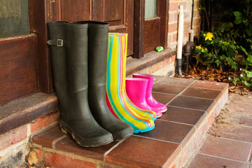Colourful wellington boots left on a doorstep