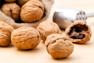 Spoed Foto op Canvas Ezel Walnuts kernels and whole walnuts on wooden background. Whole an