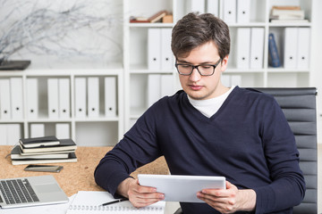 Accountant using tablet at work