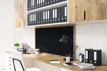 Office workspace with chalkboard side