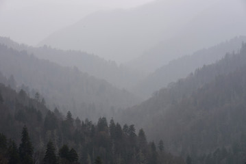 layered mountains, foggy weather Fototapete