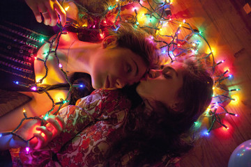 Young women illuminated by string lights