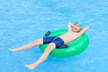 Young asian boy happy at swimming pool