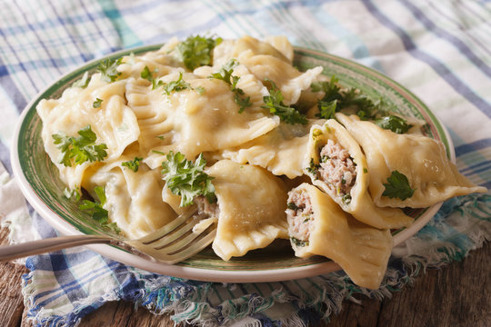 German ravioli Maultaschen with spinach and meat close up. horizontal