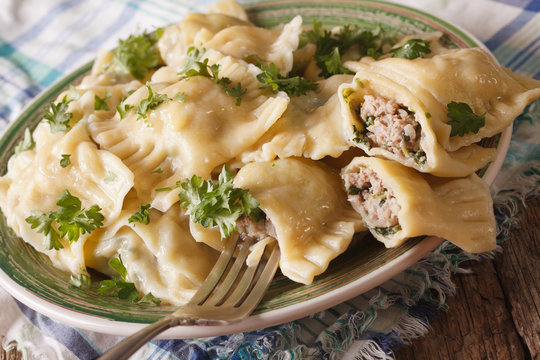 German cuisine: Maultaschen with spinach and meat close up on a plate. horizontal