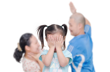 Asian girl crying with her parent fighting in background