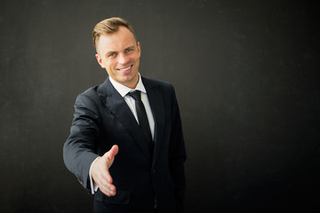 Happy business man with extended hand