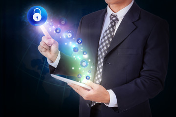 Businessman holding tablet with pressing lock icon button. internet and networking concept