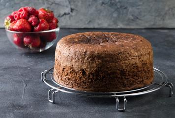 Chocolate Sponge Cake placed on metallic grill. Preparation cake