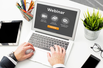 Person would join webinar on laptop