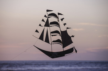The flying ship on the blue sky background
