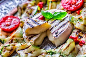 Grill Brie camembert cheese zucchini with chili pepper and olive oil. Italian mediterranean or greek cuisine. Vegan vegetarian  food.