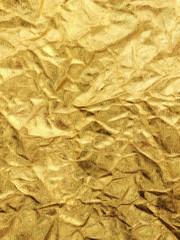 metallic crumpled gold paper texture closeup