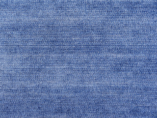 Texture of blue jeans textile close up