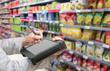 Bluetooth barcode scanner checking goods in Supermarkets