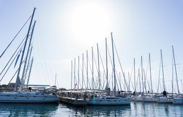 mast against a blue sky, ship mast, marina in European city, the