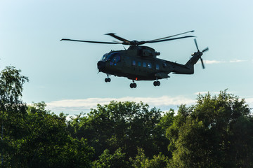 Military helicopter in the sky,close up of a military helicopter in flight
