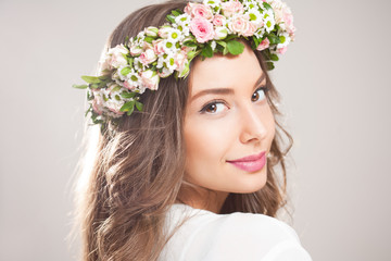 Spring beauty wearing flower wreath.