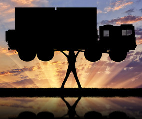 Silhouette of strong feminist, lifting trucks and reflection in the water