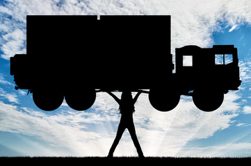 Silhouette of strong feminist, lifting trucks