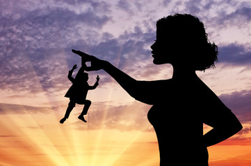 Silhouette feminist holding a small man.