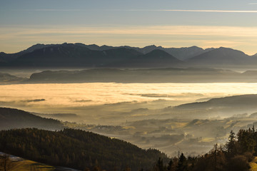 Beautiful sunset in mountains with fog in valleys.Carinthia, Austria.
