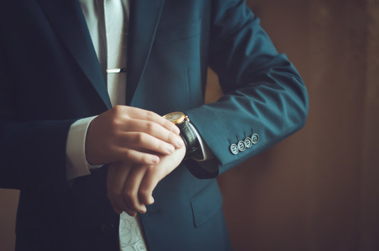Classic watches in their hands