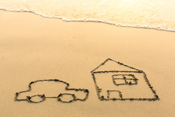 Car is near the house drawn by hand on a sandy golden sea beach.