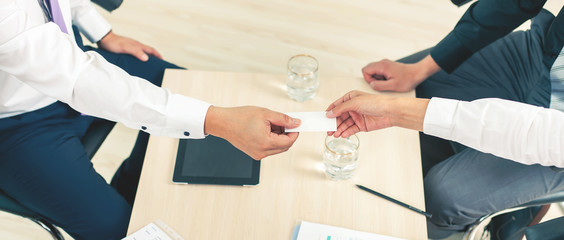 successful deal, businessman gives a business, visit card