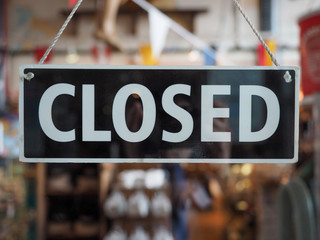 Closed sign on a shop window