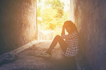 sad woman hug her knee and cry feeling so bad,loneliness,sadness