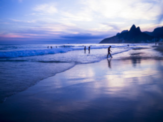 Dusk sunset scenic view of Ipanema Beach with Two Brothers Dois Irmaos Mountain on the Rio de Janeiro, Brazil city skyline
