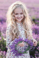 Beautiful small blond girl on the lavender field