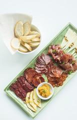 spanish serrano ham chorizo sausage and cheese tapas platter