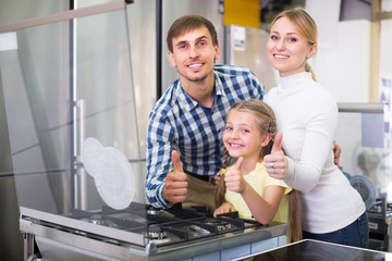 Family in store with electronics