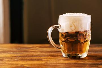 Beer mug full of cold fresh alcohol drink