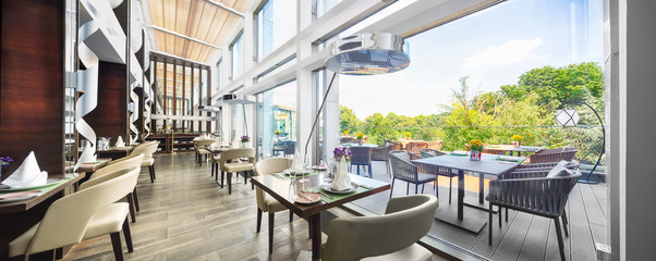 Modern restaurant interior on balcony, part of a hotel