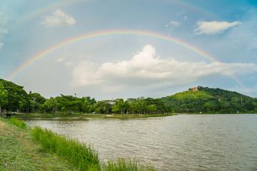The big rainbow over the sky after the rainy.